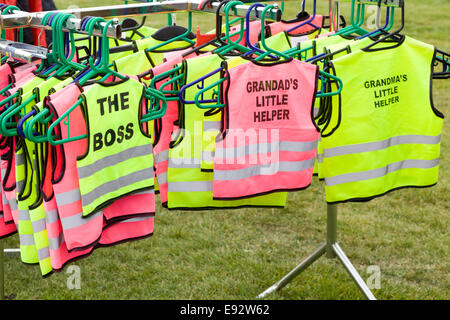Children's Hi Viz Jackets on a clothes stand - Stock Photo