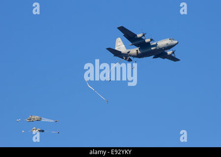 USAF C-130 Hercules drops paratroopers from the 82nd AD at Operation Market Garden memorial - Stock Photo