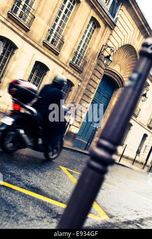 Vespa motorcycle on a street in the Marais, Paris, France - Stock Photo