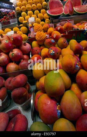 Fruits stand in La Boqueria market Barcelona, Catalonia,  Spain - Stock Photo