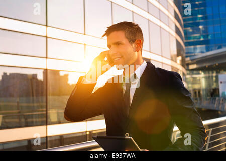 Businessman Using Phone - Stock Photo