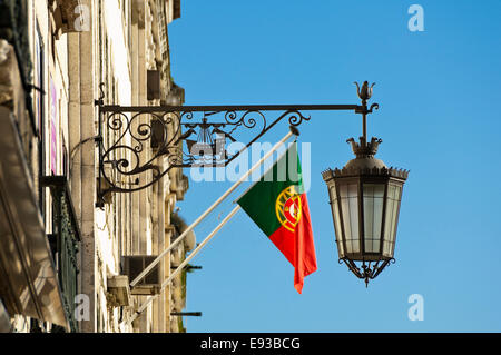 Horizontal view of a decorative wrought iron light and the national flag on the side - Stock Photo