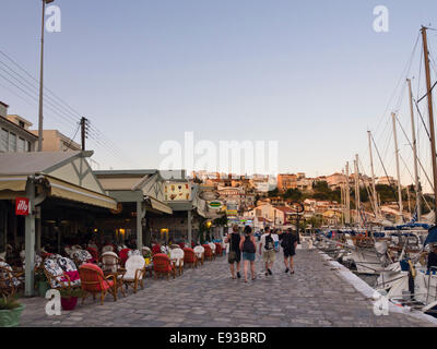 Restaurants are numerous along the harbour promenade of Phytagoreion on Samos island Greece, a summer holiday resort - Stock Photo