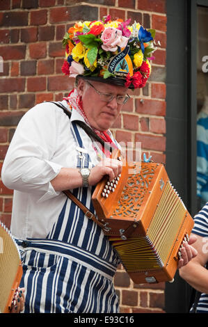 Vertical portrait of traditional North-West Morris musician playing a melodeo - Stock Photo