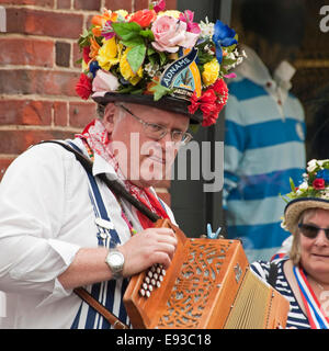 Square portrait of traditional North-West Morris musician playing a melodeon. - Stock Photo