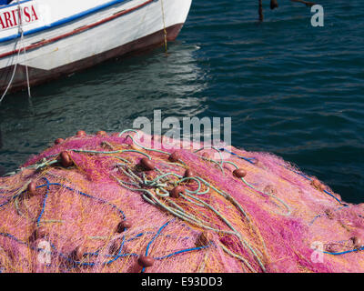 Close up of colourful fishing nets in the harbour of  Pythagorion on Samos island in Greece - Stock Photo