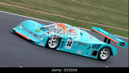Porsche 962 Group C endurance Le Mans prototype in Leyton House livery racing at the 2014 Silverstone Classic in - Stock Photo