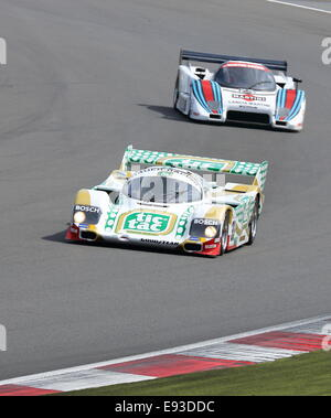 Porsche 962 Group C endurance Le Mans prototypes racing at the 2014 Silverstone Classic in the UK. - Stock Photo