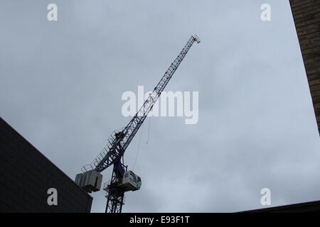 London, UK. 18th October, 2014. Elderly couple escape injury as crane hook strikes house in Upper Edmonton. Fire - Stock Photo
