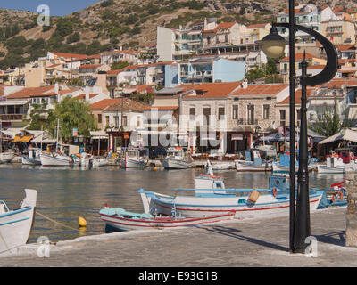 Fishing boats in the harbour of Pythagorino in Samos island Greece. Summer, sun, colours and idyllic summer impressions - Stock Photo