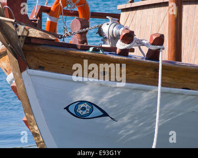 Bow of fishing boat with evil eye decoration in the harbour of Pythagorion in Samos island Greece. Summer, sun, - Stock Photo