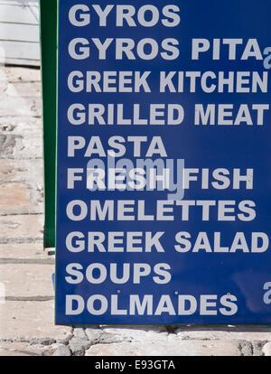 Menu board advertising local Greek food outside a restaurant in Samos island Greece - Stock Photo