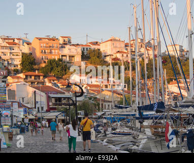 Late afternoon sunset in the harbour of Pythagorion on Samos island Greece. Tourists, restaurants and  boats - Stock Photo