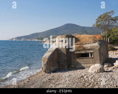 Wartime bunker on the beach of the island of Samos in Greece, ruin of defense line - Stock Photo