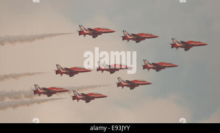Red Arrows in diamond formation over Cardiff Bay during the 2014 NATO summit meeting. - Stock Photo
