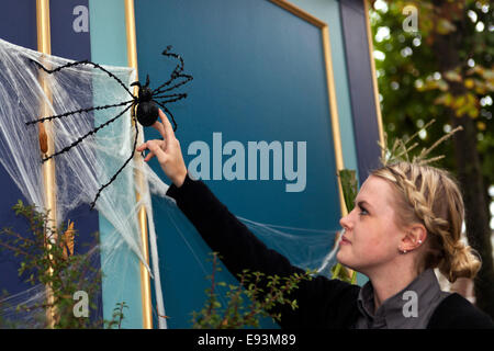 """Copenhagen, Denmark. 18th Oct, 2014. Spider love: A young woman cuddle a giant spider. """"I love him,"""" she says. """"He - Stock Photo"""