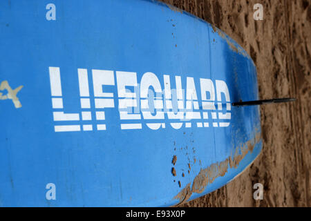Lifeguard word written on blue color lifeguard's surfboard in Calangute beach,goa.For visitors safety. - Stock Photo