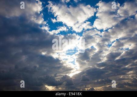 Cumulus Cloudscape white clouds in blue sky background - Stock Photo