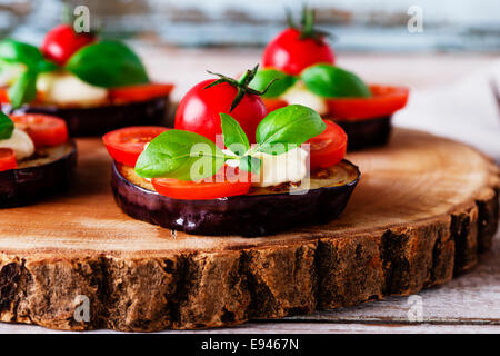 fried eggplant with cherry tomatoes and cheese - Stock Photo