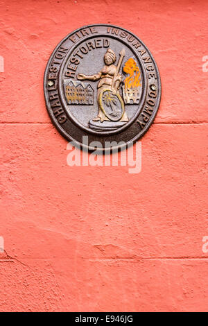 A Fire Insurance mark or plaque on a home in the French Quarter along Queen Street in historic Charleston, SC. - Stock Photo