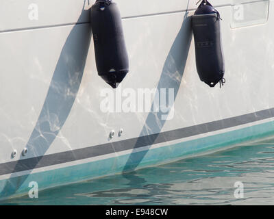 Close up of  the side of a sailboat with fenders harbour of  Pythagorion on Samos island in Greece - Stock Photo