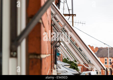 A row of open plastic windows. UPVC window frames, England, UK - Stock Photo