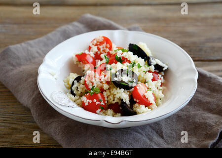 Light salad with couscous and vegetables, food - Stock Photo