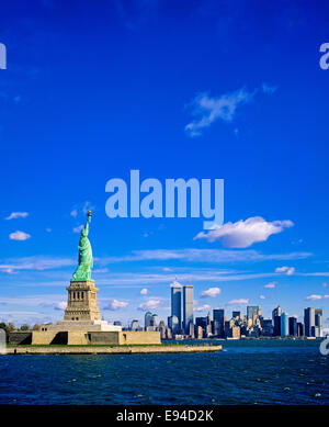Statue of Liberty and Lower Manhattan skyline prior to September 11 2001 New York City  NYC NY USA - Stock Photo