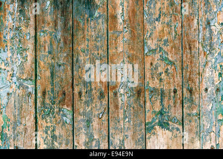 Green paint peeling from old wooden background - Stock Photo