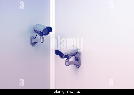Security CCTV cameras mounted on the wall. - Stock Photo