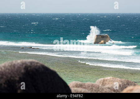 High angle view of the famous Anse Source D'Argent lagoon in La Digue, Seychelles with tall waves hitting the granite - Stock Photo