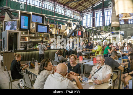 bar & crowded seating area of food court on upper floor inside magnificent Victorian cast iron structure Central - Stock Photo
