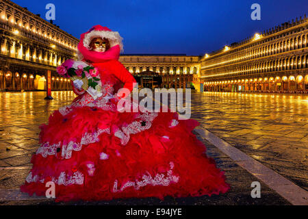 Venice Carnivale,  February 2014. A costumed Carnival model in an empty Piazza San Marco before sunrise. - Stock Photo