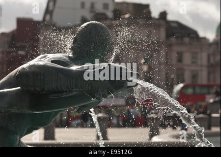 Detail of jet spray of water emerging from mouth of dolphin fountain in Trafalgar Square London - Stock Photo