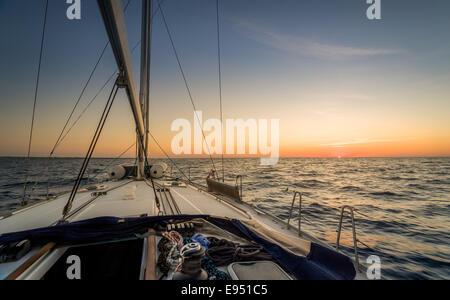 Sailing to sunset - Stock Photo