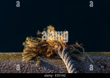 frayed rope on waterfront,rope, fray, frayed, apart, fall, breaking, twisted, natural, cord, on, hanging, white, - Stock Photo