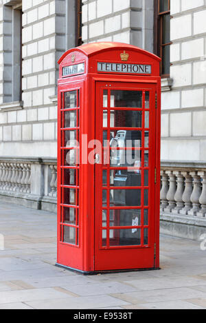 Red phone booth in Central London, London, England, United Kingdom - Stock Photo