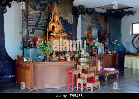 Buddha statue on an altar in a prayer hall of the Buddhist Brahma Vihara Monastery, Banjar, North Bali, Bali, Indonesia - Stock Photo