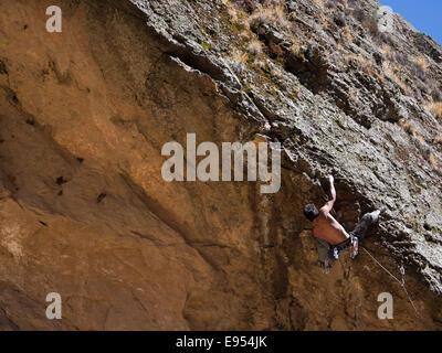 Free climber on a ridge, Cordillera Real, La Paz, Bolivia - Stock Photo