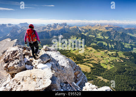 Climber descending from the Zehnerspitze over the Zehner-Ferrata in the Fanes, Fanes-Senes-Prague, view of the Val - Stock Photo
