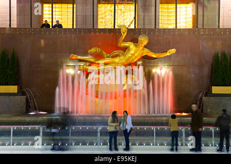 NEW YORK CITY - MARCH 31: The golden Prometheus statue at the Rockefeller center on March 31, 2012 in New York, - Stock Photo