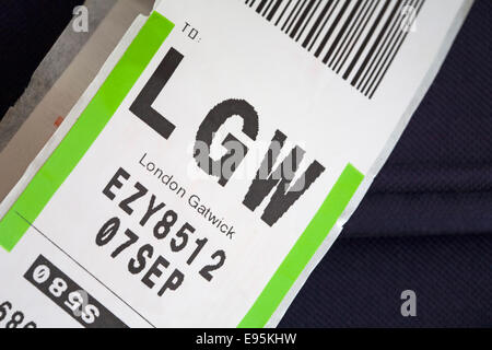 luggage label stuck on bag for LGW London Gatwick airport - Stock Photo