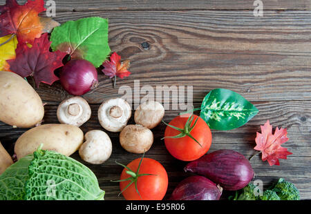 Autumn fruits and vegetables over rustic wood - Stock Photo