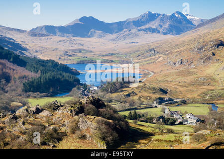 Scenic view above Capel Curig to Llynnau Mymbyr lakes and Snowdon Horseshoe in Snowdonia National Park mountains - Stock Photo
