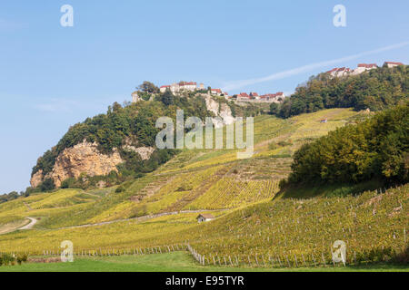 View to hilltop village above vineyards in Jura mountains wine growing region. Chateau Chalon, Jura, Franche-Comte, - Stock Photo