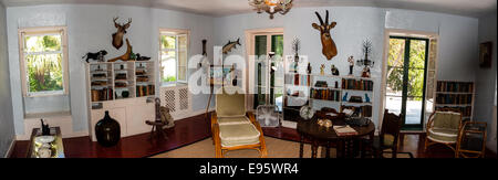 US, Florida, Key West. Interior, Ernest Hemingway Home. The Library, stitched panorama. - Stock Photo