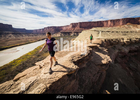 Hikers on the trail to Fort Bottom ruins from the White Rim trail near Moab, Utah. Canyonlands National Park. - Stock Photo