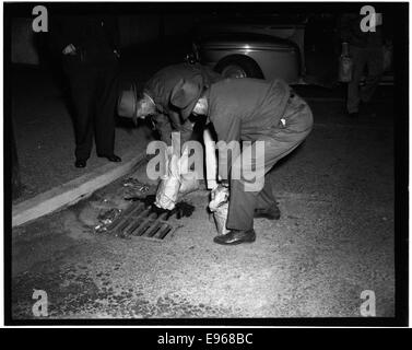 Federal Officers Dumping Whiskey, Crystal Springs, 1-15-1951 12613513085 o - Stock Photo