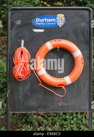 Lifebelt at the side of the river Wear, Durham city, north east England, UK - Stock Photo