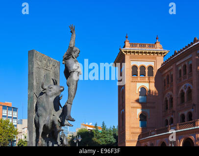 Spain, Madrid, Statue of a matador with the Plaza de Toros de las Stock Photo...